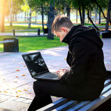 Young Man with Laptop Royalty Free Stock Photography