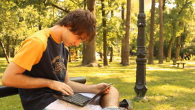 Young man and laptop stock video footage