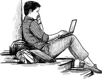 Young man with laptop in the park Royalty Free Stock Images