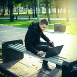 Young Man with Laptop Stock Image