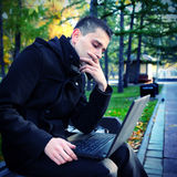 Young Man with Laptop Stock Photography