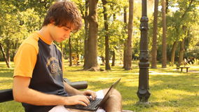 Young man and laptop stock footage