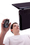 Young man on laptop, view from below, Royalty Free Stock Images