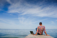 Young man with laptop working outdoor Royalty Free Stock Images