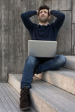 Young man with laptop worried Royalty Free Stock Photo