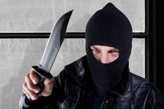 Young man with large knife Stock Photo