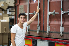 Young Man with Large White Box by Freight Train Stock Images