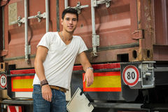 Young Man with Large White Box by Freight Train Royalty Free Stock Photos