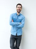 Young man laughing with arms crossed Royalty Free Stock Images