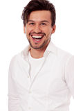 Young man laughing at camera isolated Royalty Free Stock Photo