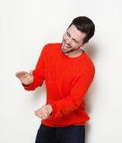 Young man laughing and clapping hands Royalty Free Stock Image