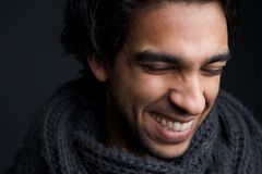 Young man laughing with gray scarf Royalty Free Stock Photography