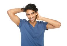 Young man laughing with hand in hair Royalty Free Stock Image