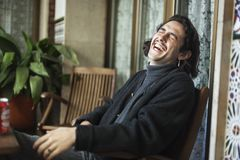 Young man laughing a terrace. stock photography