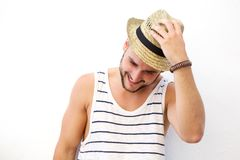 Young man laughing with hat Stock Photography