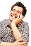 Young man laughing with his eyes closed Stock Photos