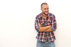Young man laughing and looking away Stock Images