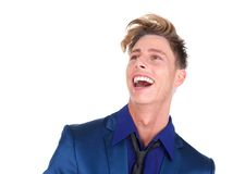 Young man laughing and looking up Royalty Free Stock Photos