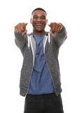 Young man laughing and pointing finger. Close up portrait of a young man laughing and pointing finger Royalty Free Stock Photo