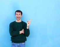 Young man laughing and pointing finger Royalty Free Stock Photography
