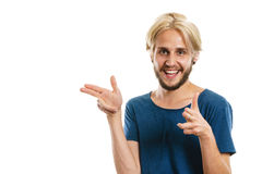 Young man laughing pointing with fingers. Concept of joy, positive emotion. Happy joyful young man, stylish bearded male smiling laughing, pointing with fingers Royalty Free Stock Photos