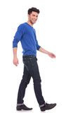Young man laughing and walking stock photos