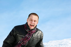 Young man laughs merrily in winter Stock Image