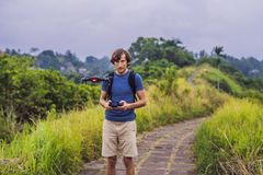 Young man launches a drone into the sky. The island of Bali.  stock image