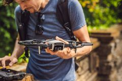 Young man launches a drone into the sky. The island of Bali.  royalty free stock photos
