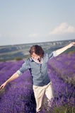 Young man among the lavender fields. Stock Photos