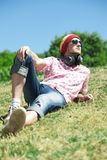 Young man  laying on grass Royalty Free Stock Photos