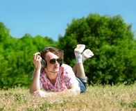Young man  laying on grass Royalty Free Stock Images
