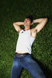 Young man laying on the grass Royalty Free Stock Photos
