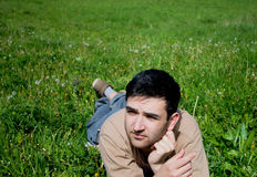 Young man laying in a meadow Royalty Free Stock Photos