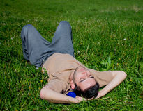 Young man laying in a meadow Royalty Free Stock Image