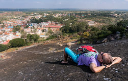 Young man is laying on a mountain and having rest Stock Image