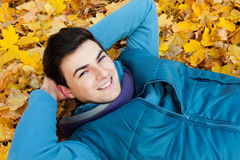 Young man laying in park. Stock Photo
