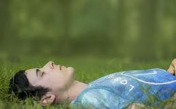 Young man laying quiet on grass Royalty Free Stock Images