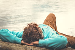 Young Man laying relaxing outdoor Royalty Free Stock Image