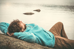 Young Man laying relaxing outdoor Royalty Free Stock Images