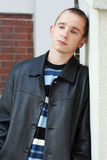 Young man leaning against wall Royalty Free Stock Photography