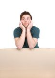 Young man leaning on blank poster Stock Photo