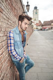 Young man leaning on a brick wall Royalty Free Stock Photography
