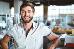 Young man leaning on the counter looking the camera Stock Photography