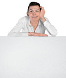 Young man leaning empty board Stock Image