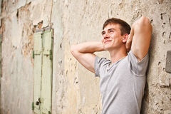 Young Man Leaning On A Grunge Wall Stock Photos