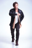 Young man in leathe jacket in a fashion pose Stock Photos