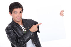 Young man in a leather jacket Stock Photography