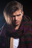 Young man in leather jacket and a big scarf Royalty Free Stock Image