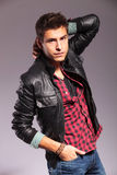 Young man in leather jacket in a fashion pose Royalty Free Stock Photo
